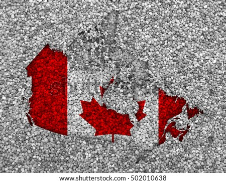 Map and flag of Canada on poppy seeds