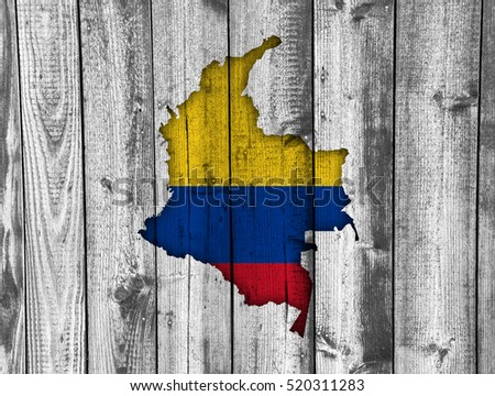 Map and flag of Colombia on weathered wood