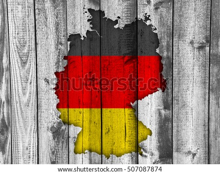 Map and flag of Germany on weathered wood