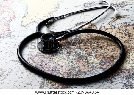 Map and stethoscope - stock photo