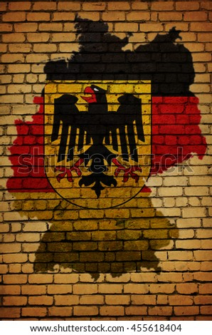 Map, flag and symbol of Germany on a brick background - stock photo