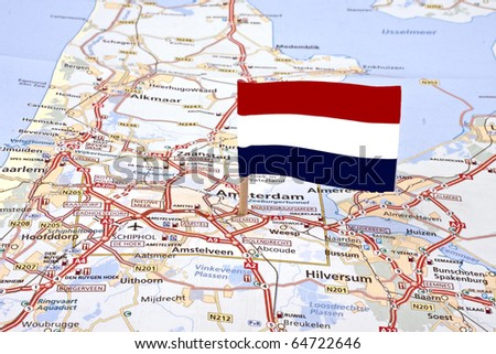 Map from the Netherlands with the dutch flag pointed at the capital Amsterdam - stock photo