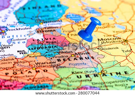 Map of Belarus with a blue pushpin stuck - stock photo