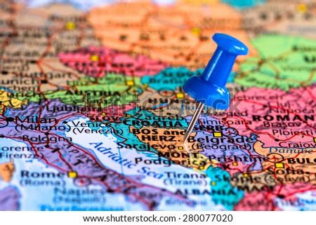 Map of Bosnia and Herzegovina with a blue pushpin stuck - stock photo