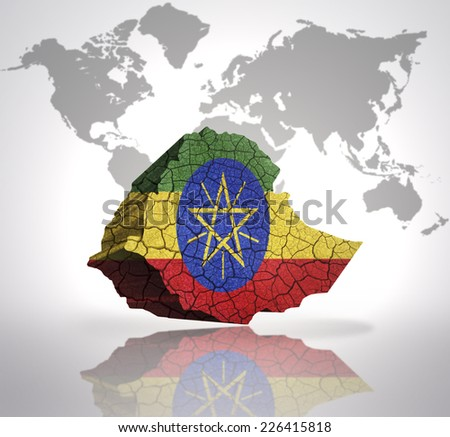 Map of Ethiopia with Ethiopian Flag on a world map background - stock photo