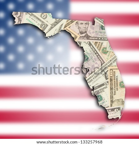 Map of Florida, filled with many dollars - stock photo