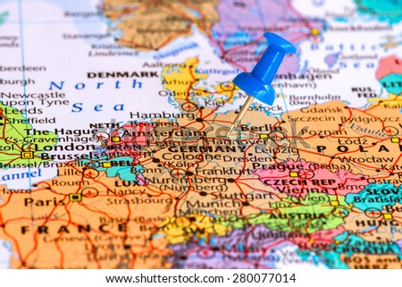 Map of Germany with a blue pushpin stuck - stock photo
