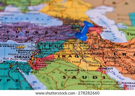Map of Iraq with a blue pushpin stuck - stock photo