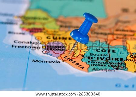 Map of Liberia with a blue pushpin stuck - stock photo