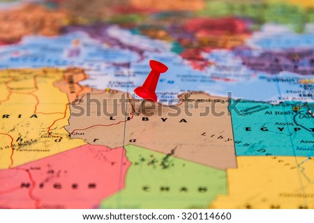 Map of Libya with a red pin - stock photo