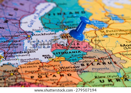 Map of Lithuania with a blue pushpin stuck - stock photo