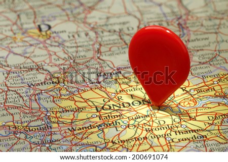 Map of London/Red map pointer stuck into of London - stock photo