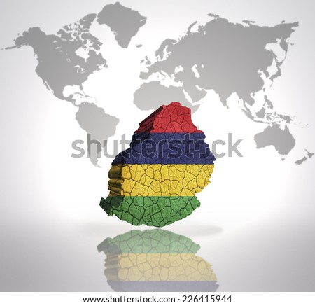 Map of Mauritius with Mauritius Flag on a world map background - stock photo
