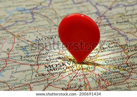 Map of Moscow/Red map pointer stuck into of Moscow - stock photo