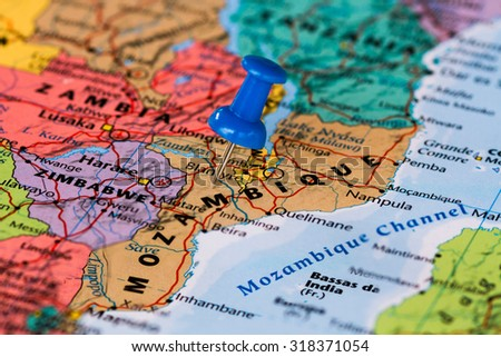 Map of Mozambique with a blue pushpin stuck - stock photo