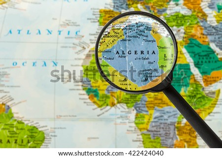 Map of People's Democratic Republic of Algeria through magnigying glass - stock photo