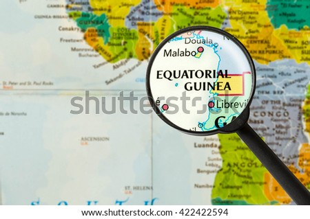 Map of Republic of Equatorial Guinea through magnigying glass - stock photo