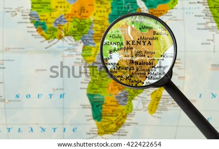 Map of Republic of Kenya through magnigying glass - stock photo