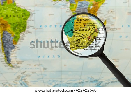 Map of Republic of South Africa through magnigying glass - stock photo
