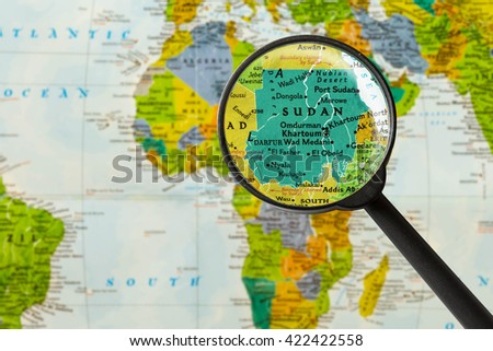 Map of Republic of the Sudan through magnigying glass - stock photo