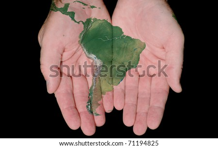 Map Of South America Painted On Hands Showing Concept Of South America In Our Hands - stock photo
