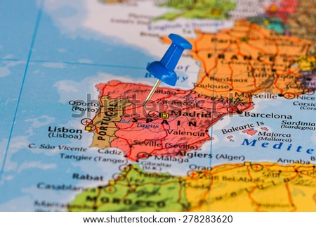 Map of Spain with a blue pushpin stuck