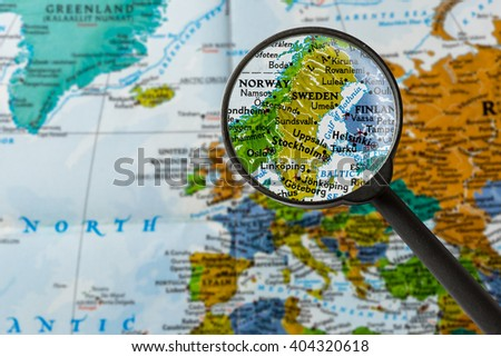map of Sweden through magnifying glass - stock photo