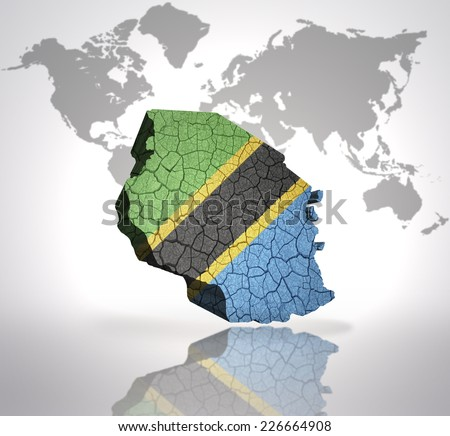 Map of tanzania with tanzanian Flag on a world map background - stock photo