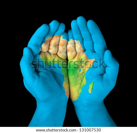 Map of the continent of Africa painted on hands - stock photo