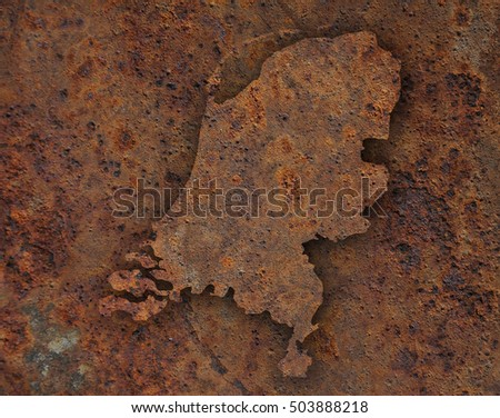 Map of the Netherlands on rusty metal
