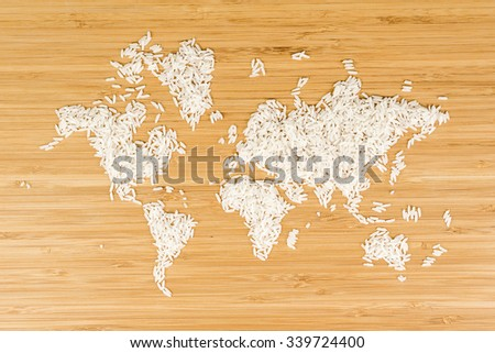 map of the world made of white rice on bamboo wood background - stock photo
