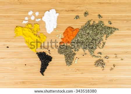 map of the world made of white various condiments and food ingredients on bamboo wood background - stock photo