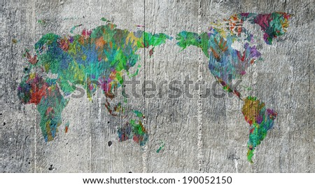 Map of the world with the people of earth represented by hands in different colors. Conceptual image of population, global friendship and teamwork.