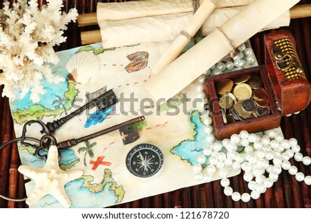 map of treasures on dark wooden background - stock photo