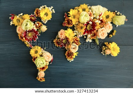 Map of world made from different kinds of flowers, close-up - stock photo