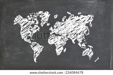 Map on a chalk board with chalk stains - stock photo