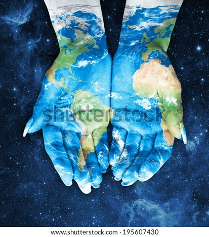 Map painted on hands.Concept of having the world in our hands in space - stock photo