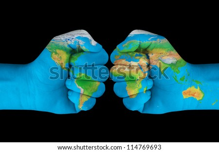 Map painted on hands showing concept of having the crash of the world in our hands