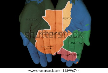 Map Painted On Hands Showing The Concept Of Having Guatemala In Our Hands - stock photo