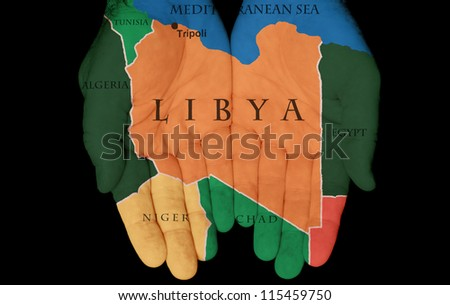 Map Painted On Hands Showing The Concept Of Having Libya In Our Hands - stock photo