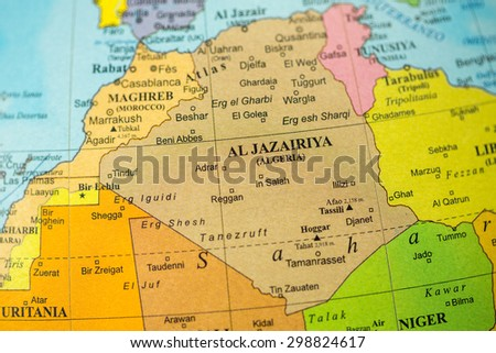 Map view of Algeria on a geographical globe.
