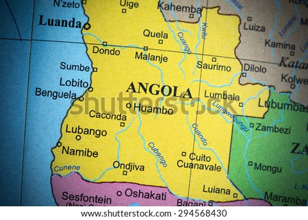 Map view of Angola on a geographical globe. (vignette)