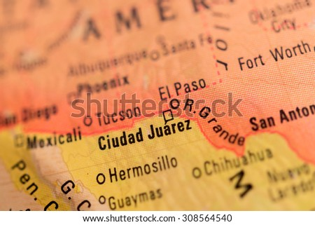 Map view of Ciudad Juarez on a geographical glove - stock photo