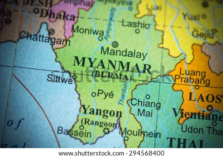 Map view of Myanmar on a geographical globe. (vignette) - stock photo