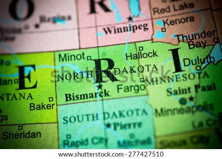 Map view of North Dakota on a geographical globe. (vignette) - stock photo