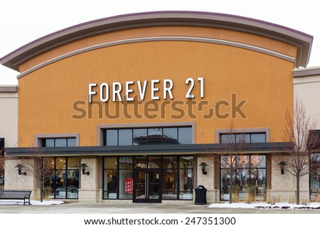 MAPLE GROVE, MN/USA - JANUARY 16, 2015: Forever 21 retail store exterior. Forever 21 is an American chain of fashion retailers with its headquarters in Los Angeles, California. - stock photo