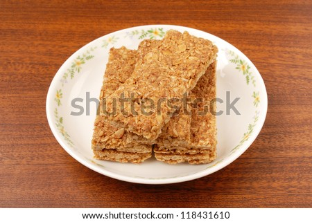 Maple syrup coconut biscuits on plate - stock photo