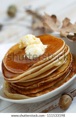 Maple syrup pancakes with orange butter - stock photo