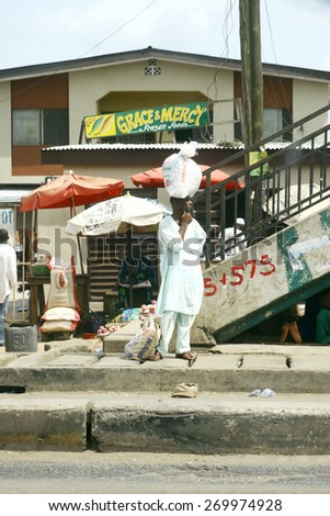 MAR 29, 2007 LAGOS, NIGERIA Street view, passenger on public transport station - stock photo