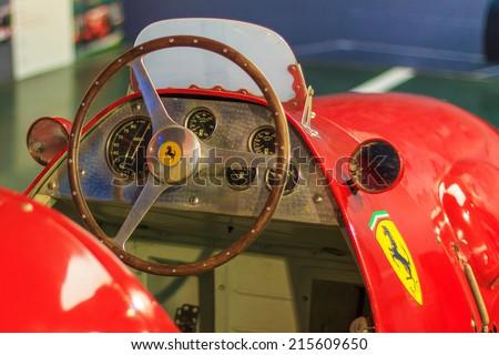 MARANELLO, ITALY APRIL 30, 2014: A closeup of an interior of old Ferrari model in Ferrari  showroom in Maranello factory. - stock photo